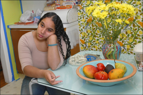 On the cusp of her 18th birthday, Maria Medina, in the kitchen of her foster home, wrestles with decisions about her future and her family.