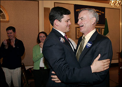 First-time City Council candidate John Connolly (left) greeted his father, Michael Connolly, at the Sons of Italy hall in Roslindale yesterday.
