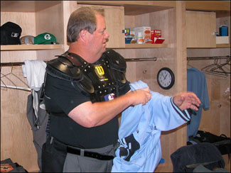 Umpire Joe West dons the uniform before a recent game at Fenway. (Boston.com Photo / David Ropeik) <a href='http://www.boston.com/sports/baseball/redsox/gallery/09_09_05_umps/' onclick='openWindow('http://www.boston.com/sports/baseball/redsox/gallery/09_09_05_umps/','','width=775,height=585,resizable=yes,scrollbars=yes,toolbar=no,location=no,menubar=no,status=no'); return false;'> Photo gallery