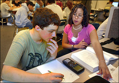 Senior Tamara Emerson tutored freshman John Clancy in his geometry lesson at Framingham High School's Academic Development Center.