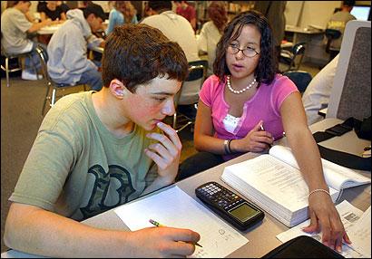 Senior Tamara Emerson tutored freshman John Clancy in his geometry lesson at Framingham High School's Academic Development Center.