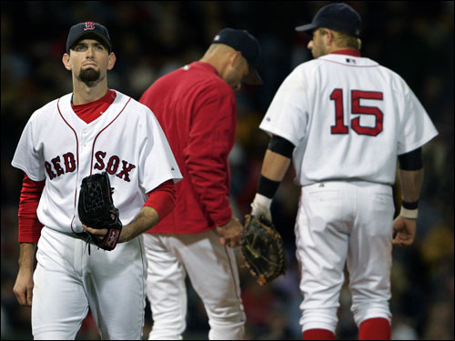Red Sox starting pitcher Matt Clement (left) left the game after giving up four runs in just over five innings. Manager Terry Francona (center) Kevin Millar (right) waited on the mound for reliever Mike Myers.