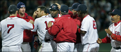 Ortiz was mobbed by his teammates after his game-winning hit dropped in safely in the bottom of the ninth inning.