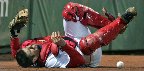 Red Sox catcher Jason Varitek made a valiant effort, but he couldn't come up with Russ Adams' sixth inning foul pop behind the plate.