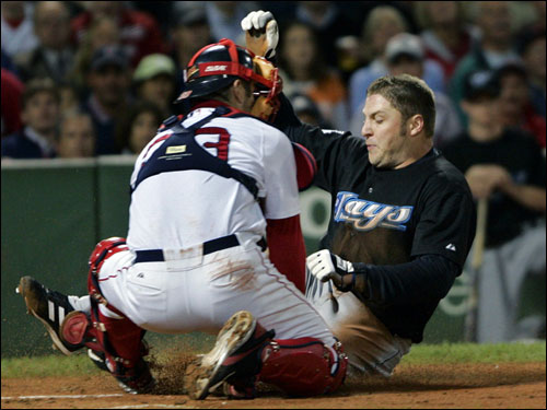 Blue Jays first baseman Eric Hinske slid in with the first run of the game in the second inning, beating the throw to Red Sox catcher Jason Varitek.