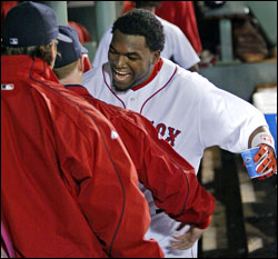 Walkoff hero David Ortiz celebrated in the dugout after last night's win over the Blue Jays. (Globe Staff Photo / Jim Davis) &nbsp;<a href='http://www.boston.com/sports/baseball/redsox/gallery/09_30_05_sox_jays' onclick='openWindow('http://www.boston.com/sports/baseball/redsox/gallery/09_30_05_sox_jays','','width=775,height=585,resizable=yes,scrollbars=yes,toolbar=no,location=no,menubar=no,status=no'); return false;'> Game photos &nbsp;<a href='http://www.boston.com/sports/baseball/redsox/gallery/ortizwalkoffs' onclick='openWindow('http://www.boston.com/sports/baseball/redsox/gallery/ortizwalkoffs','','width=775,height=585,resizable=yes,scrollbars=yes,toolbar=no,location=no,menubar=no,status=no'); return false;'> Ortiz's walkoffs &nbsp;<a href='http://www.boston.com/sports/baseball/redsox/gallery/09_15_05_ortiz' onclick='openWindow('http://www.boston.com/sports/baseball/redsox/gallery/09_15_05_ortiz','','width=775,height=585,resizable=yes,scrollbars=yes,toolbar=no,location=no,menubar=no,status=no'); return false;'> Case for Ortiz