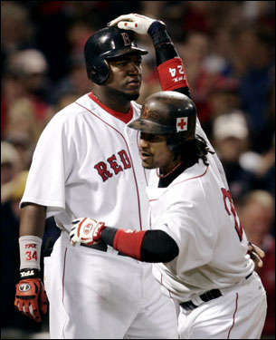 Ortiz (left) and Manny Ramirez (right) celebrated after scoring on Ramirez's two-run home run in the sixth inning.
