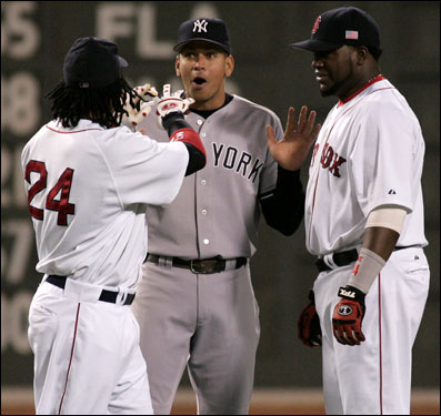Alex Rodriguez (center) took a hands-off approach when talking with Red Sox sluggers Manny Ramirez (left) and David Ortiz (right) prior to last night's game.