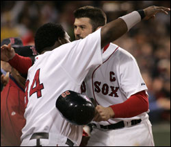 Big Papi has a big hug for his captain after Jason Varitek launched a Monster shot leading off the second inning. (Globe Staff Photo / Jim Davis) &nbsp;<a href='http://www.boston.com/sports/baseball/redsox/gallery/10_01_05_sox_yankees' onclick='openWindow('http://www.boston.com/sports/baseball/redsox/gallery/10_01_05_sox_yankees','','width=775,height=585,resizable=yes,scrollbars=yes,toolbar=no,location=no,menubar=no,status=no'); return false;'> Game photos &nbsp;<a href='http://www.boston.com/sports/baseball/redsox/gallery/10_01_05_scene' onclick='openWindow('http://www.boston.com/sports/baseball/redsox/gallery/10_01_05_scene','fridayscene','width=775,height=585,resizable=yes,scrollbars=yes,toolbar=no,location=no,menubar=no,status=no'); return false;'> Fenway scene &nbsp;<a href='http://www.boston.com/sports/baseball/redsox/extras/slideshows/soxyanks_finalseries/'> Audio slideshow