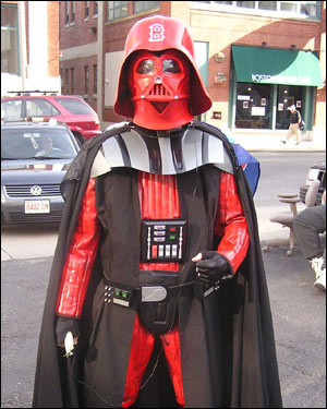John Ovesen, 23, of Roslindale, decided to take matters into his own hands in taking the Evil Empire's mascot, Darth Vader, away from Yankee fans, and dressing him up for Boston. 'I didn't think Wally was good enough,' he said.
