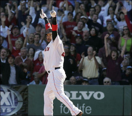 Manny Ramirez reached to the sky after his monstrous first-inning homer sailed over the Green Monster.