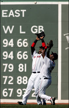 Manny Ramirez avoided Edgar Renteria to record an out in the second inning.