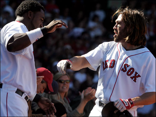 Johnny Damon scored on the Ramirez home run and was congratulated by David Ortiz.
