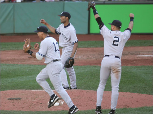 When it was all over, the Yankees claimed an 8-4 victory and the AL East title. Derek Jeter, Mariano Rivera, and Alex Rodriguez celebrated.