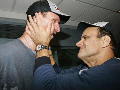 Joe Torre embraced Randy Johnson, the pitcher that clinched the AL East for the Yankees.