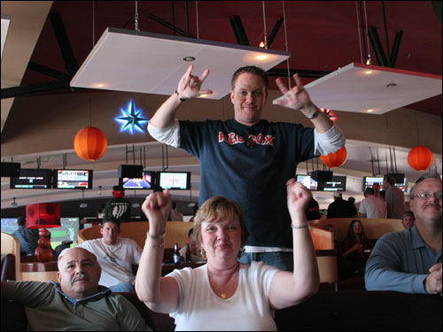 Inside Jillian's, Pat Gunton (bottom) celebrated Manny's shot with her son, Rich Gunton (top), Pat's husband Pedro Claudio (L), and Pat's brother, Jim (R). 'My godmother and uncle are from New Jersey,' Rich explained. 'I'm an Angels fan,' Jim clarified. 'I like the Red Sox more than the Yankees.'