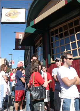 Fans lined up outside the Cask 'n Flagon, waiting to see the game inside on the bar's enormous big-screen.