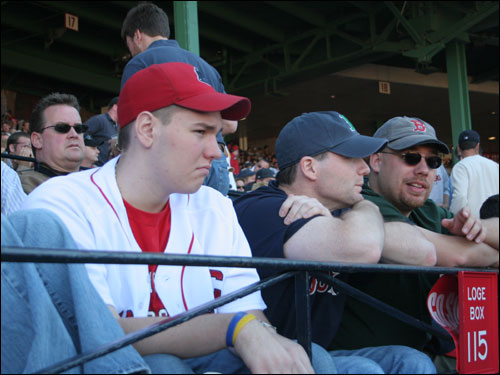 Inside Fenway Park, Sox fans William Landry (Left), Burlington, Marc Vigeant (Center), Burlington, Vt., and Dan Cristelli, Burlington, Vt. sat subdued as Alex Rodriguez crossed the plate in the 8th inning on a fielder's choice.