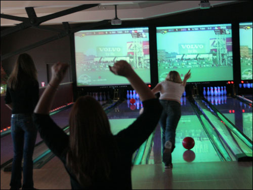 Two New York Yankees fans celebrated in a bowling alley on the third floor of Jillian's in Boston, as the Red Sox and Yankees battled down the street.