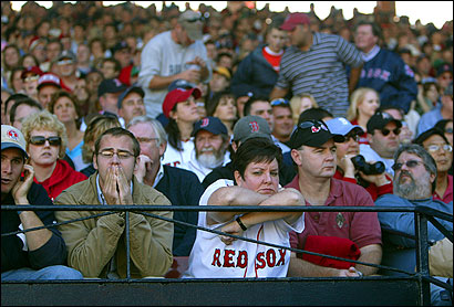 Red Sox fans like Jeanne Sullivan and her husband, Evan (right), were dismayed with yesterday's loss.