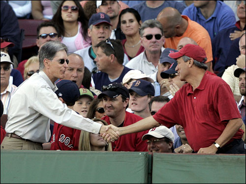 Red Sox principal owner John Henry (left) shook Sox president Larry Lucchino's hand (right) after they learned the Red Sox had clinched the AL wild card.