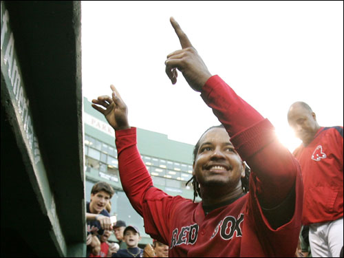 Manny Ramirez gestured to the fans as he went to join his teammates in celebration.
