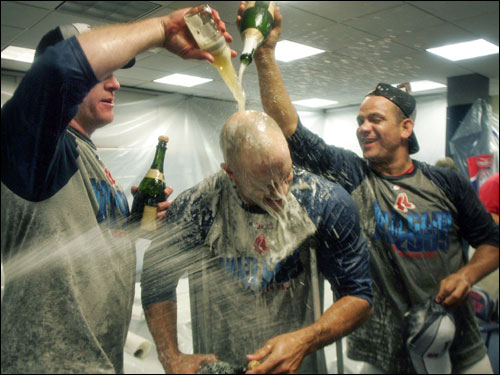 Gabe Kapler, out for the season with an achilles injury, was still able to celebrate with his teammates.