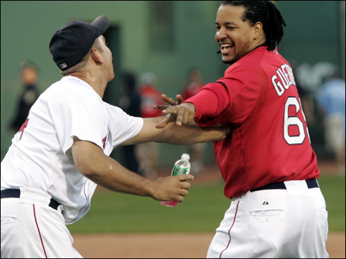 Manny Ramirez ran away from pitcher Jeremi Gonzalez after the game.