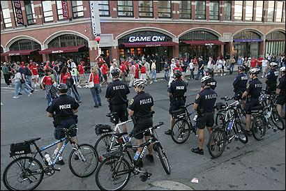 Police bike patrols helped keep the crowds peaceful after the Red Sox victory yesterday.
