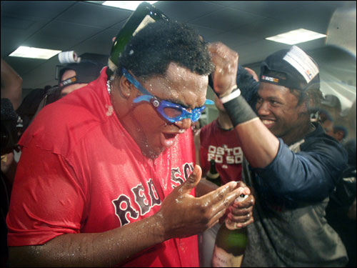 David Ortiz (left) got champagne poured down his back by Hanley Ramirez (right).
