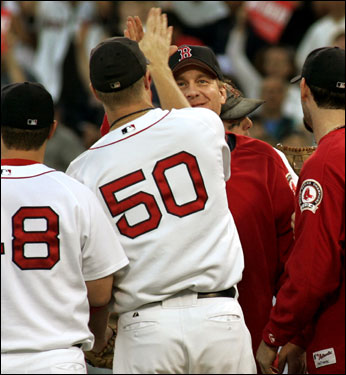 Curt Schilling (facing) and the closer, Mike Timlin (50) got together on the field for an exchange of high fives after the game.