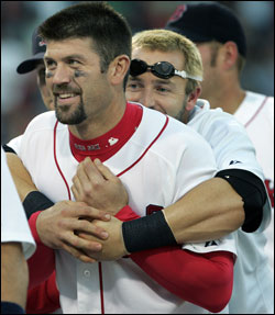 Jason Varitek and Kevin Millar are going wild again for the Red Sox. (Globe Staff Photo / Jim Davis) &nbsp;<a href='http://www.boston.com/sports/baseball/redsox/gallery/10_02_05_celebration' onclick='openWindow('http://www.boston.com/sports/baseball/redsox/gallery/10_02_05_celebration','','width=775,height=585,resizable=yes,scrollbars=yes,toolbar=no,location=no,menubar=no,status=no'); return false;'> Celebration &nbsp;<a href='http://www.boston.com/sports/baseball/redsox/gallery/10_02_05_sox_yankees' onclick='openWindow('http://www.boston.com/sports/baseball/redsox/gallery/10_02_05_sox_yankees','','width=775,height=585,resizable=yes,scrollbars=yes,toolbar=no,location=no,menubar=no,status=no'); return false;'> Game photos &nbsp;<a href='http://www.boston.com/sports/baseball/redsox/gallery/10_02_05_scene' onclick='openWindow('http://www.boston.com/sports/baseball/redsox/gallery/10_02_05_scene','','width=775,height=585,resizable=yes,scrollbars=yes,toolbar=no,location=no,menubar=no,status=no'); return false;'> Sunday scene