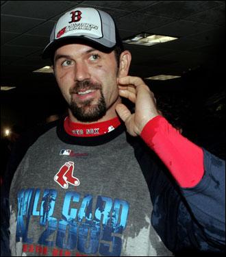 Jason Varitek smiled in the locker room after he got soaked in his team's post-game celebration.