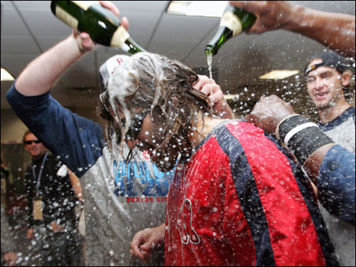 Johnny Damon was doused with champagne by teammates.