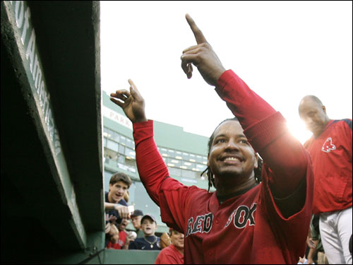 Manny Ramirez gestured to the fans as he headed into the dugout after the game.