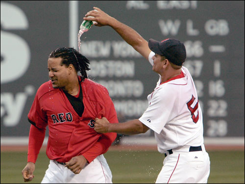 Manny Ramirez (left) had a bottle of water poured on his head by Jeremi Gonzalez.