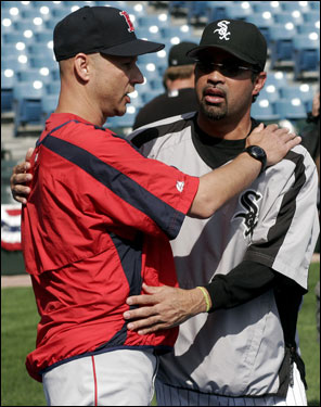 White Sox manager Ozzie Guillen (right) and Red Sox skipper Terry Francona (left) share a hug before Tuesday's Game 1 of the ALDS in Chicago.