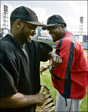 Carl Everett (left) clowned around with David Ortiz (right) before the game.