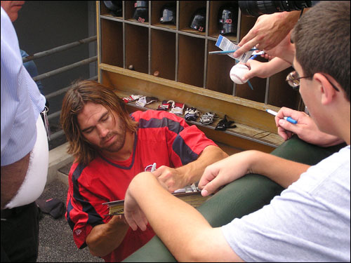 Johnny Damon signed autographs before Tuesday's game in Chicago.