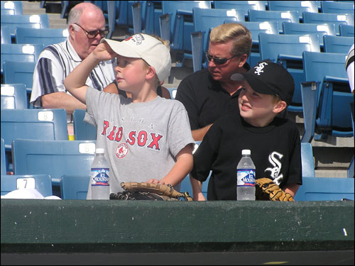 These two young fans' rooting interests are in direct conflict.