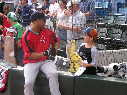 Red Sox infielder Alex Cora talked with a young White Sox fan before Tuesday's game.