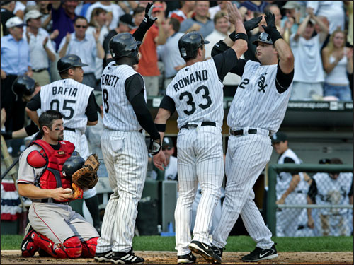 Red Sox catcher Jason Varitek (left) had a close-up view of the celebration of the White Sox at home plate, and he didn't seem to be enjoying the show, as Carl Everett (8), and Aaron Rowand (33), greeted Pierzynski (right) at home plate.