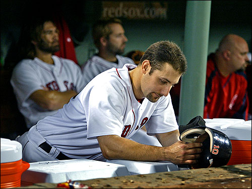 Red Sox players sat in disappointment at the end of the game. In the foreground is Tony Graffanino. In the backround, left to right, are Johnny Damon, Kevin Millar, and David Wells.