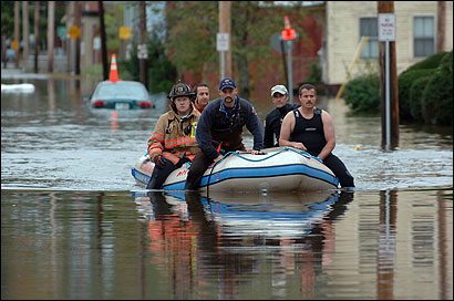 On Water Street in Keene, N.H., rescue workers sought stranded people.
