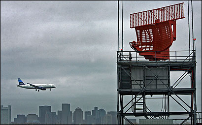 A replacement radar antenna, the red object at left, yesterday ended a malfunction that delayed flights into Logan International Airport for two full days, according to Massport and FAA officials.