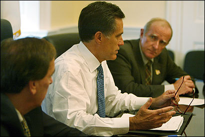 Governor Mitt Romney met yesterday with state lawmakers, including Senators Brian Lees (left) and Stephen Brewer.