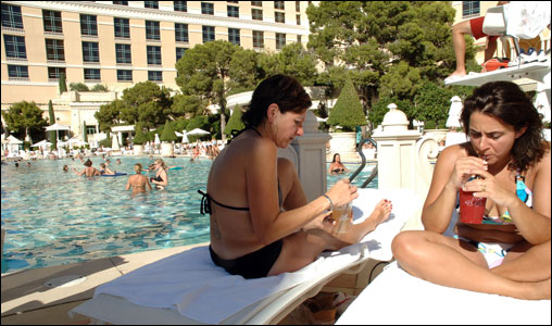 What could be better than an afternoon swim followed by an afternoon cocktail? Vacationers enjoy their day at the pool at the Bellagio Hotel, one of Las Vegas' top hotels.