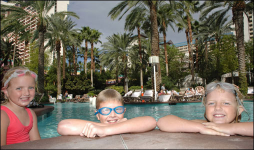 Kids enjoy the sun at the Flamingo Pool after riding the waterslides.