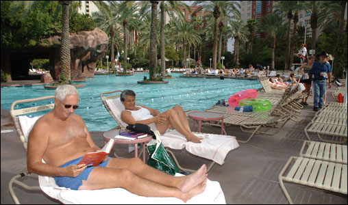 Relaxing and reading under the shade of palm trees are two common sights at the Flamingo Pool.