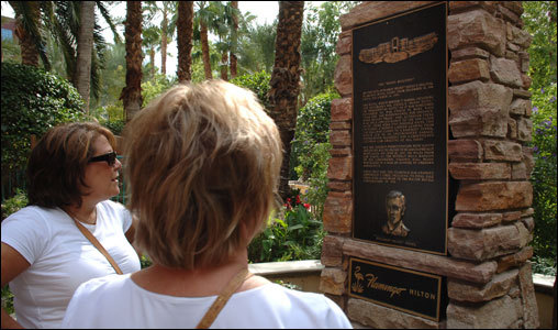 Guests view the Bugsy Seigel memorial at the Flamingo Pool.